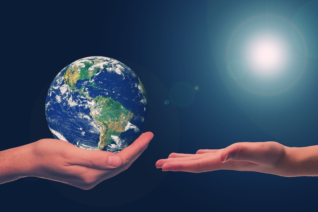 Globe in hand to represent Sustainable Event Planning